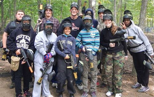 Jason's physical fitness helps him to do youth ministry like this paintball event.